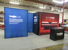 Custom Inline Exhibit with Double-sided SuperNova LED Lighboxes and Custom Reception Counter with Locking Storage -- Front
