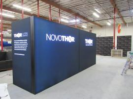 Custom Inline Exhibit with Double-sided SuperNova LED Lighboxes and Custom Reception Counter with Locking Storage -- Back